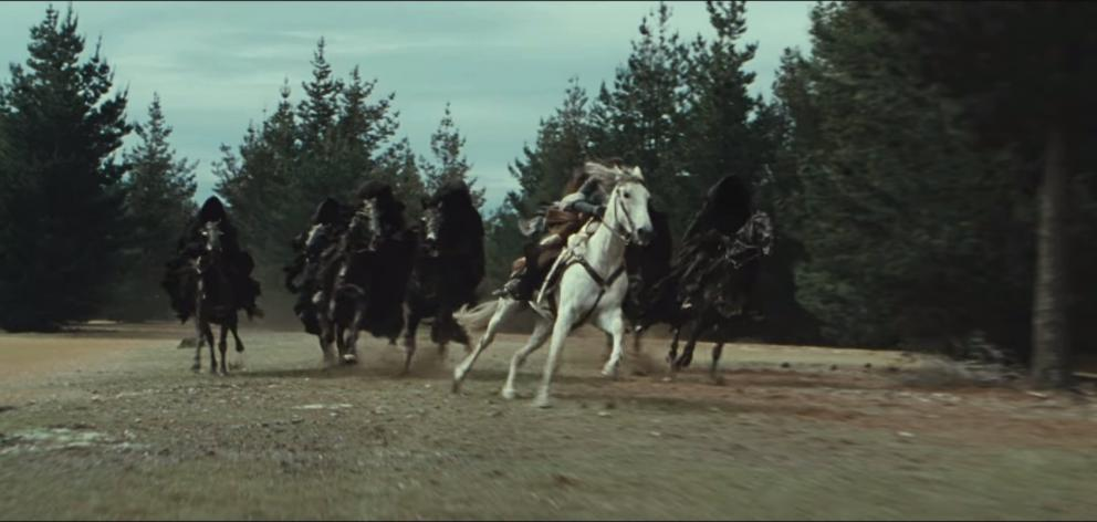 A scene from The Fellowship of the Ring movie filmed in a pine plantation near Tarras. Photo: New...