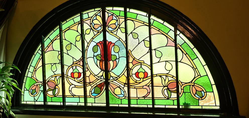 The stained glass window just inside the front door makes a grand first impression.