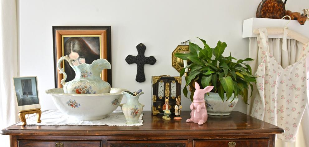 Paintings, ceramics and potted plants bring character and life to the rooms.