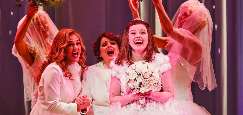 Muriel Hyslop (Maggie McKenna) tries on her dream wedding dress in  a scene from Muriel's Wedding...