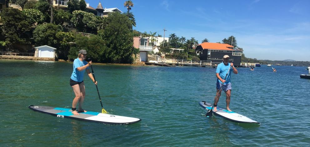 Watson's Bay proved the ideal place for a stand-up paddle boarding lesson. PHOTO: TERRY MCDERMOTT...