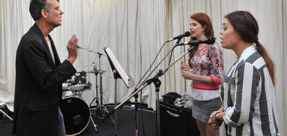 Graeme Downes and vocalists Molly Devine (left) and Kylie Price rehearse a song  for the  Tally...