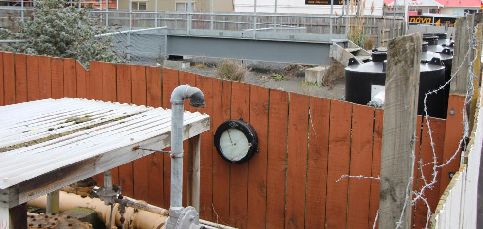 Over the fence abutting the Hillside Rd footpath to the former Dunedin Gasworks is an underground...