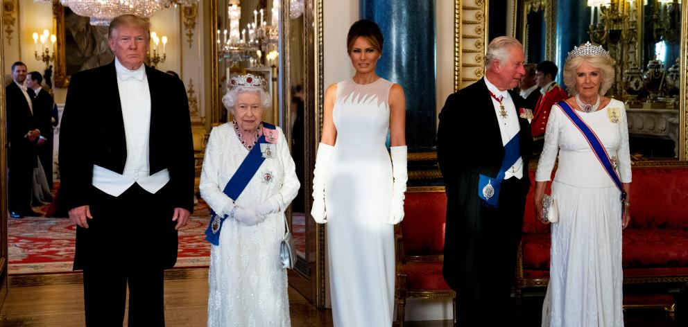 From left: Donald Trump, Melania Trump, the Queen, her son Prince Charles, the Prince of Wales...