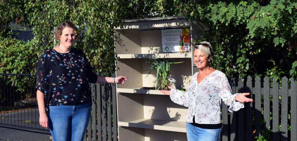 Saddle Hill Community Board deputy chairwoman Leanne Stenhouse (left) and community fruit and...