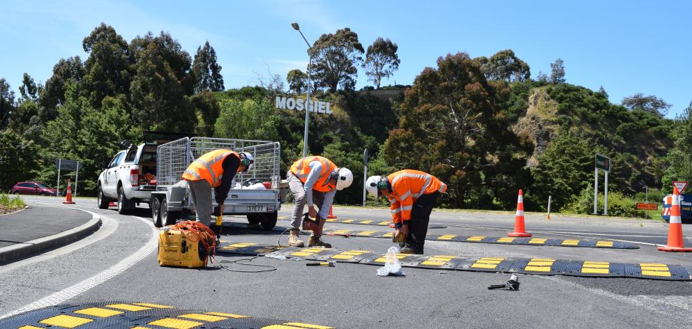 Downer contractors work on an Southern Motorway off-ramp intersection of State Highways 1 and 87...
