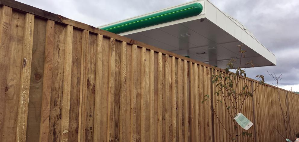 The new fence at the back of Murray Stephen's house in Irvine St provides a barrier to theBP...
