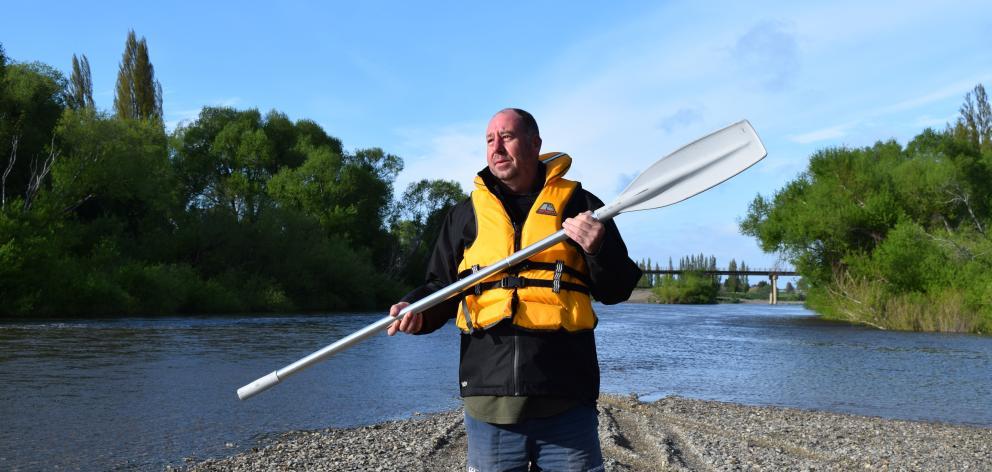 Outram raft race organiser Carl Gardner at the Taieri River. PHOTO: SHAWN MCAVINUE