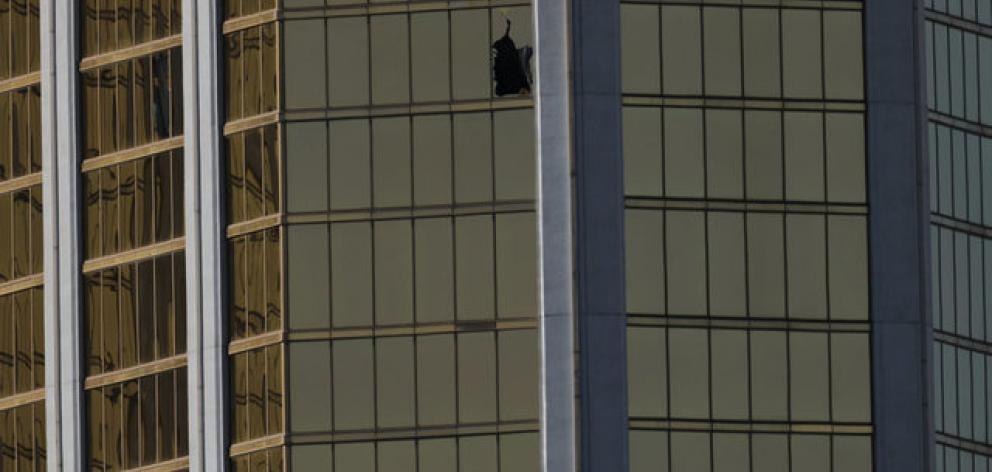 A broken window is seen at The Mandalay Bay Resort and Casino. Photo: Reuters