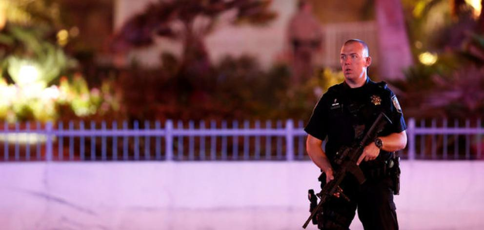 A law enforcement officer stands in front of the Tropicana hotel-casino after the mass shooting at a music festival in Las Vegas. Photo: Reuters