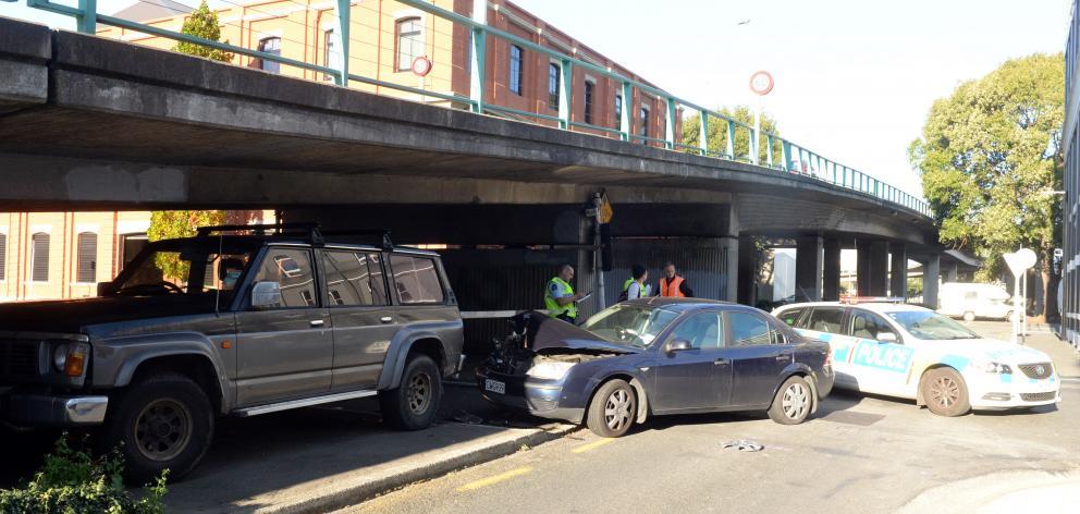 A third car was damaged near the overbridge. Photo: Linda Robertson