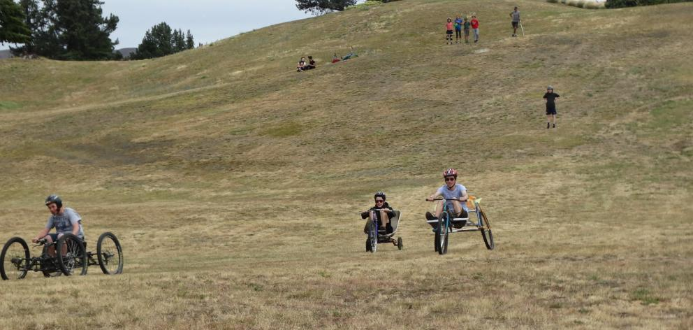 James Hey and Michael Hey (17), of Wanaka, race each other in a  go-kart derby down a hill near...