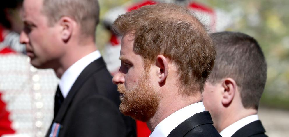 Prince William (legt) and Prince Harry follow the coffin of their grandfather on Saturday. Harry...