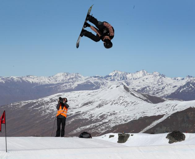 New Zealand snowboarder Carlos Garcia-Knight takes to the sky during his final run on his way to...