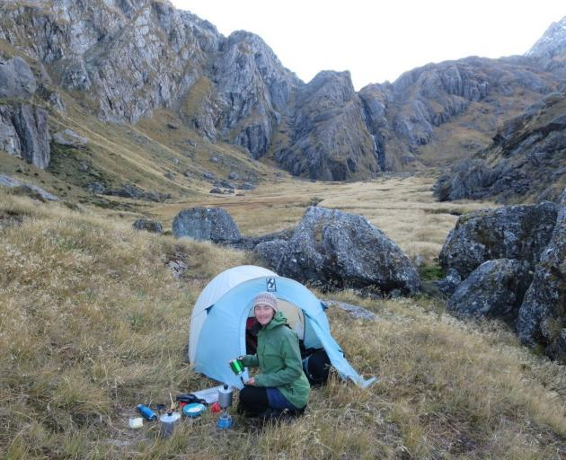 Petrina making a cup of tea at our campsite in the Valley of the Trolls. Photo: Alina Suchanski