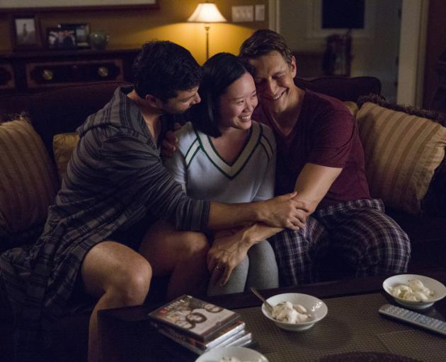 Alex Quijano (left), Michelle Ang and Robert Gant in a scene from the season of from 13 Reasons...