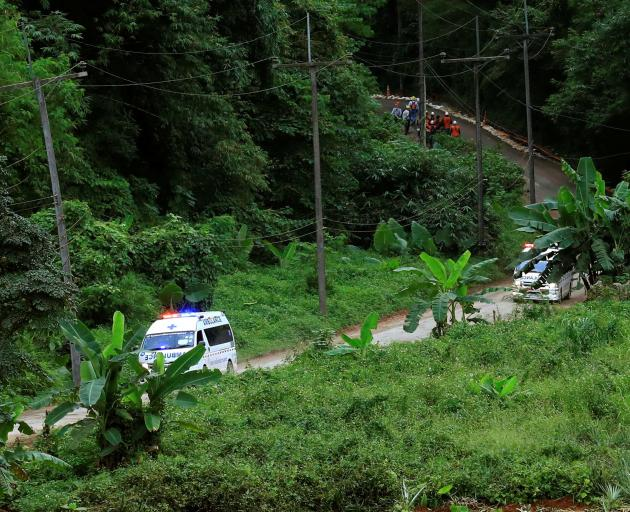 A group of ambulances travels from the Tham Luang Nang Non cave complex in northern Thailand. ...