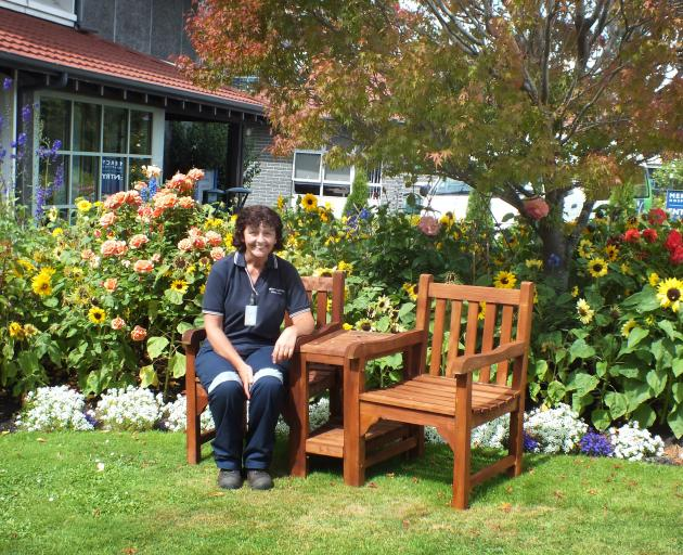 The only permanent gardener at Mercy Hospital, Emma Paul takes a seat, a rare occurrence during...
