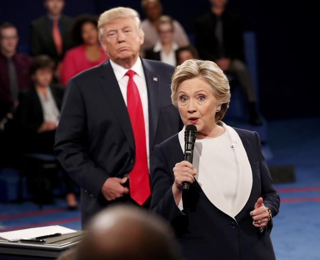 Hillary Clinton and Donald Trump during a debate held before the election. Photo: Reuters