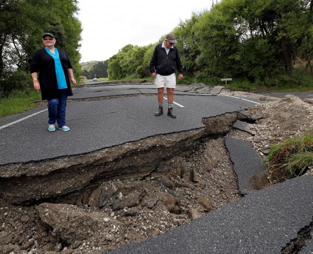 Local residents Chris and Viv Young look at damage caused on State Highway 1, near Blenheim....