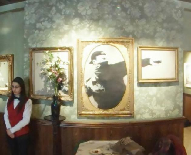 Banksy's art lines the walls of the stylised piano bar in the Walled Off hotel in the West Bank...