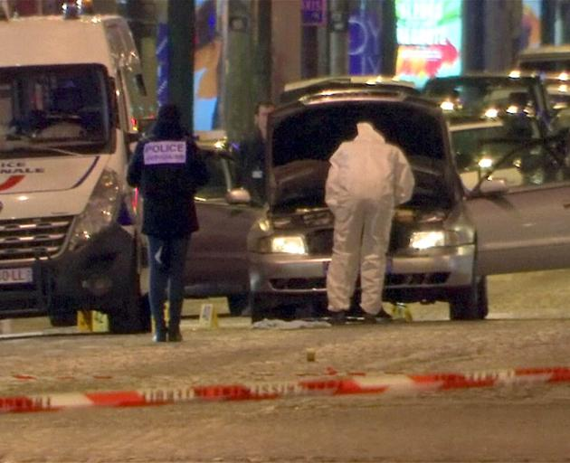 Police inspect the car used by the attacker. Photo: Reuters
