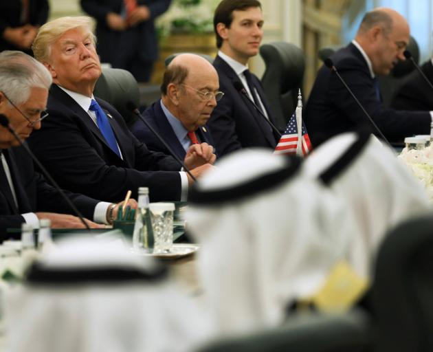 President Donald Trump (second left) and his delegation sit down to meet with Saudi Arabia's King...