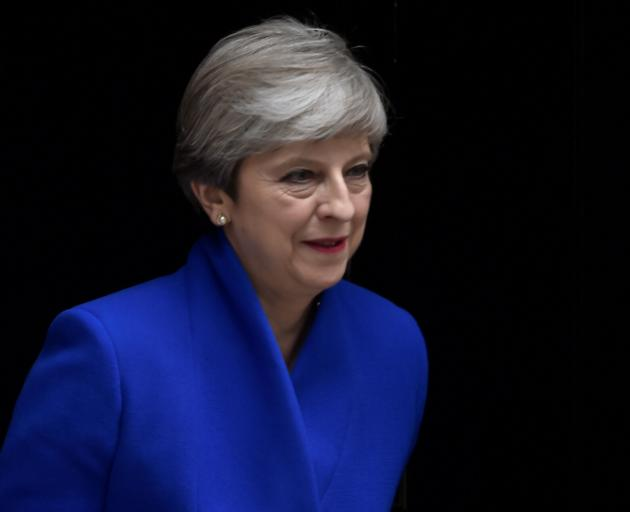 British PM Seeks Minority Government Following Election Losses