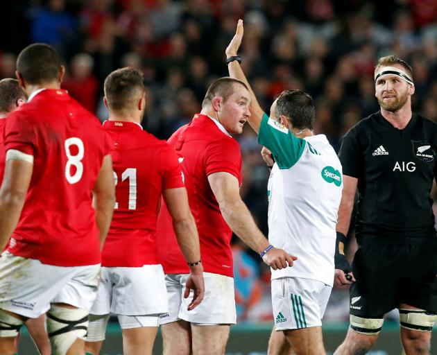 All Black captain Kieran Read (right) reacts after no penalty was given for the offside of Lions'...