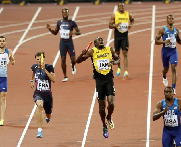 Jamaica's Usain Bolt pulls up during the final leg of the race. Photo: Reuters