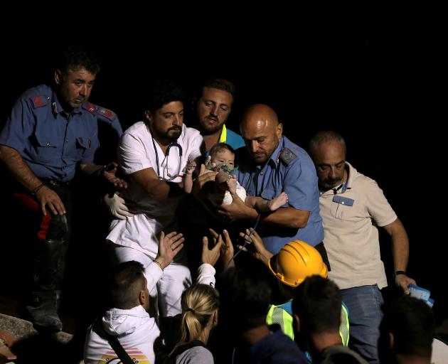 Rescuers found a baby boy called Pasquale in the wreckage and pulled him out alive seven hours...