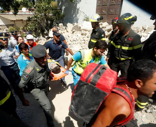 Another boy was rescued earlier in the day. Photo: Reuters