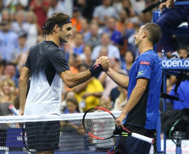 Roger Federer shakes hands with Philipp Kohlschreiber after the match. Photo: Jerry Lai-USA TODAY...