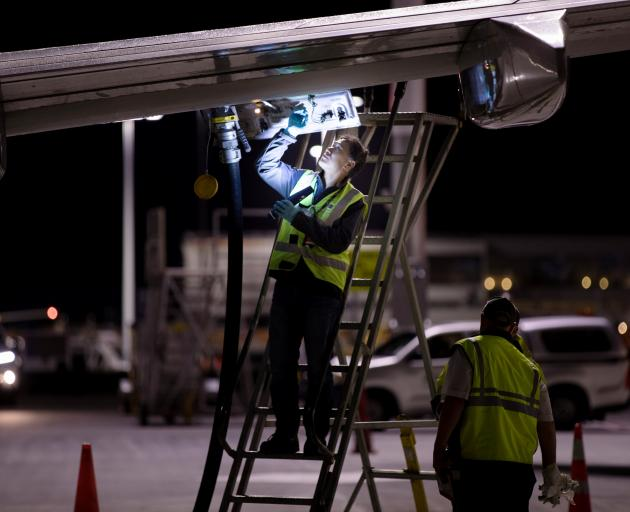 Jet fuel is siphoned directly between two Qantas aircraft on the tarmac of Auckland Airport....