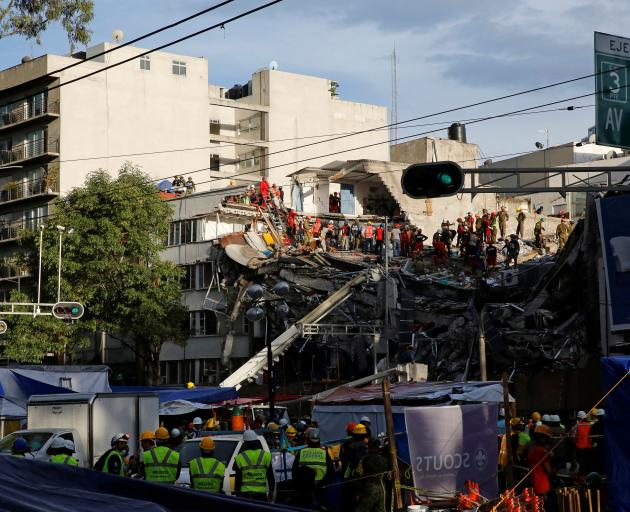 Rescue teams continue to search for survivors in the rubble of a collapsed building in Mexico City. Photo: Reuters