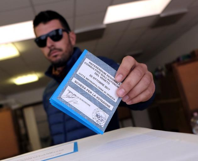A man casts his vote for Veneto's autonomy referendum at a polling station in Venice. Photo: Reuters