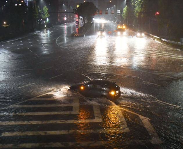 A waterlogged road in in Nagoya. Photo: Kyodo via Reuters