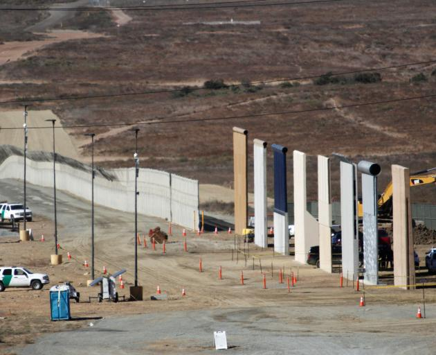 Prototypes for Donald Trump's border wall with Mexico are shown near completion. Photo: Reuters