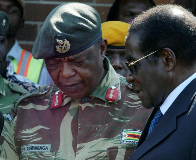 General Constantino Chiwenga with President Robert Mugabe. Photo: Reuters
