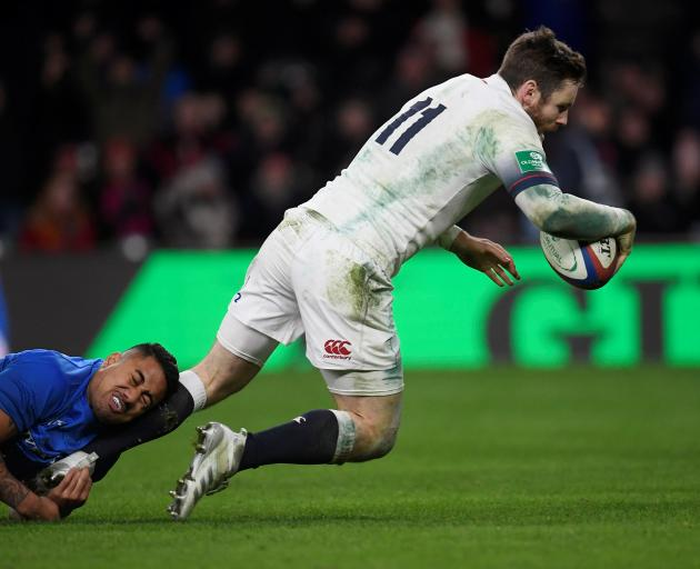 Elliot Daly scores a try despite desperate defence from Samoa at Twickenham. Photo: Reuters