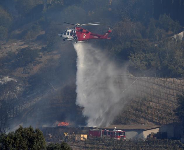 A building burns on Rupert Murdoch's vineyard. Photo: Reuters