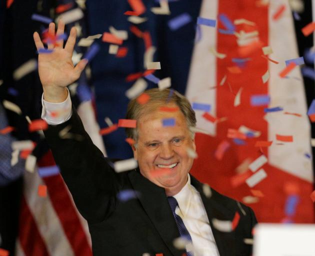 Doug Jones acknowledges supporters at the election night party in Birmingham, Alabama. Photo:...