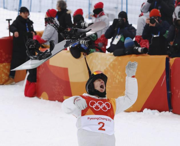 Shaun White tosses his board as he celebrates his win. Photo: Reuters