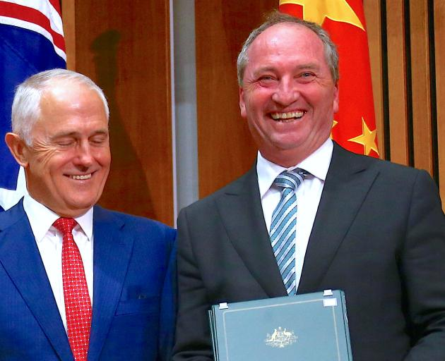 Prime Minister Malcolm Turnbull (left) with Barnaby Joyce. Mr Joyce will remain in parliament,...