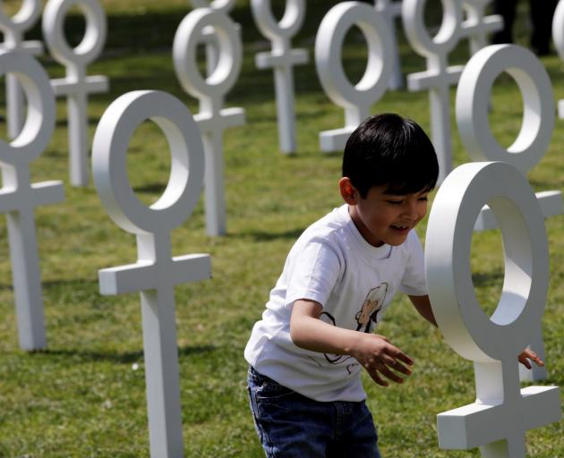 A child by some Venus symbols at an event  in Mexico where UN women and rights groups and rights...