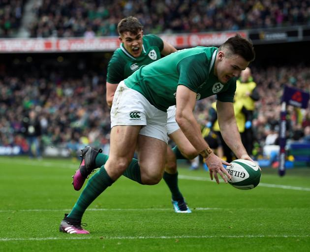 Jacob Stockdale scores for Ireland in Dublin. Photo: Reuters