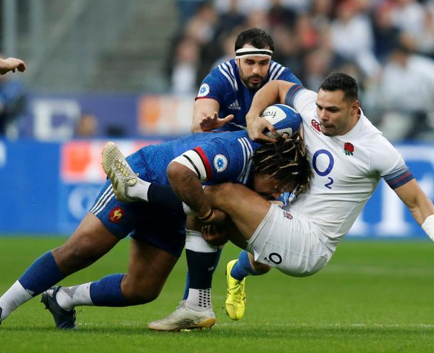 England's Ben Te'o is tackled by France's Mathieu Bastareaud. Photo: Reuters