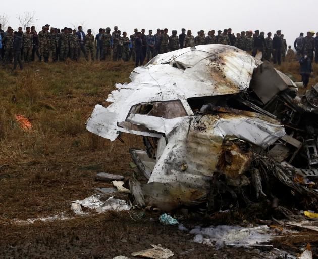 Bangladeshi plane with 67 passengers crashes near Kathmandu airport