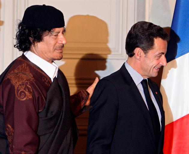 Muammar Gaddafi (left) and Nicolas Sarkozy after the signing of a trade deal in Paris in 2007....