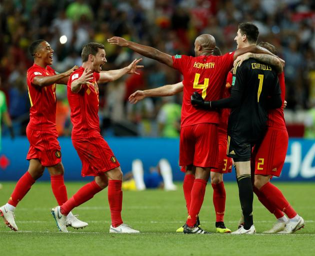 Belgium players celebrate beating Brazil. Photo: Reuters